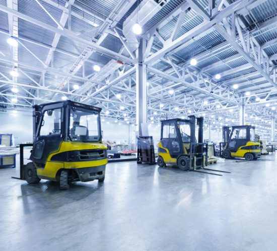 A row of fork-lift trucks in a warehouse - Boyd Insurance