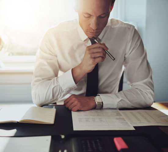 A professional completing paperwork - Boyd Insurance