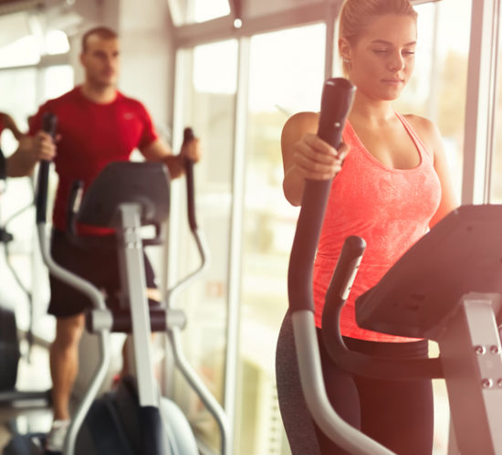 People using gym equipment in a sports centre - Boyd Insurance
